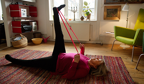 Healthy citizen working out at home